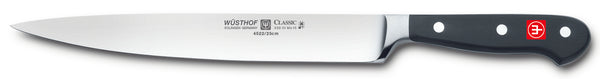4522-7/23 wusthof classic 9 inch carving knife. riveted handle.