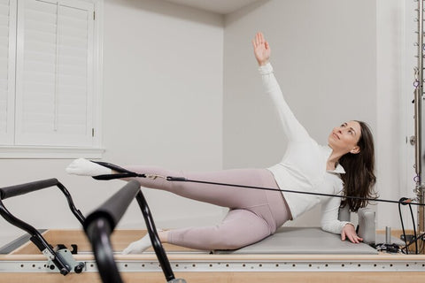 Woman doing Pilates workout in Vancouver.