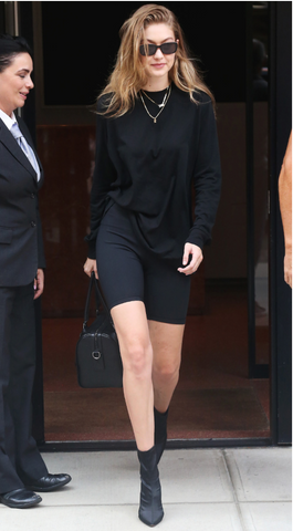 Gigi Hadid in black bike shorts model off duty look.