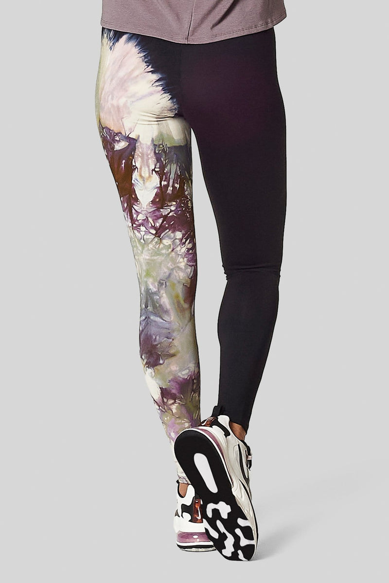 Back view of a woman wearing tie-dyed, made in Canada leggings