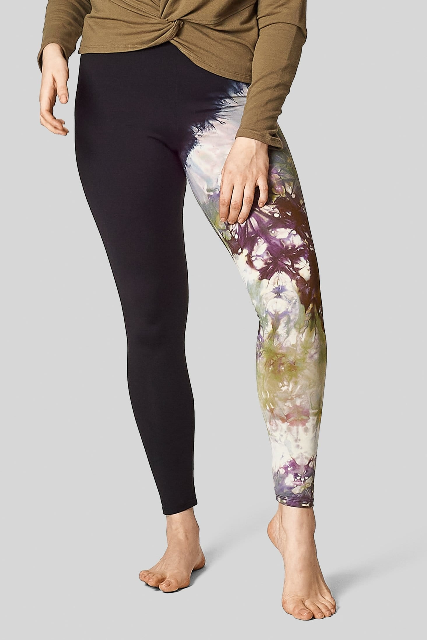 A size 12 model wears a pair of hand-dyed activewear leggings.