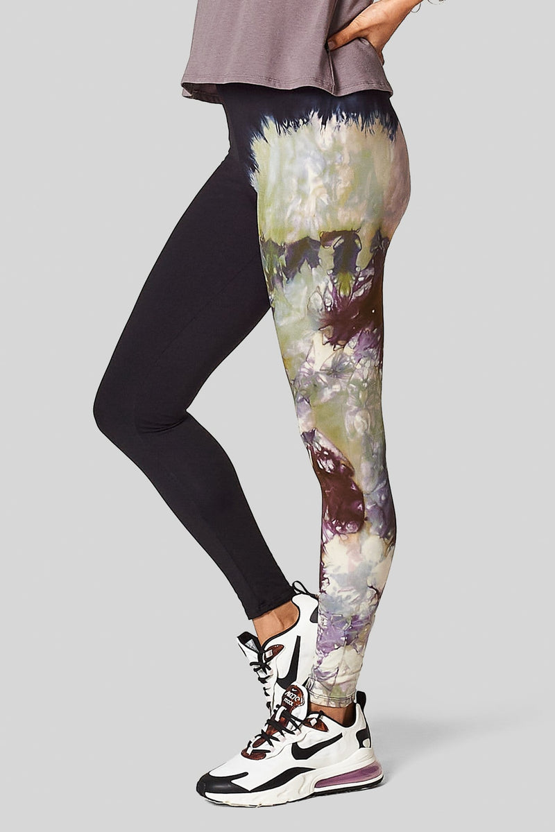 Side view of a woman wearing tie dye leggings.