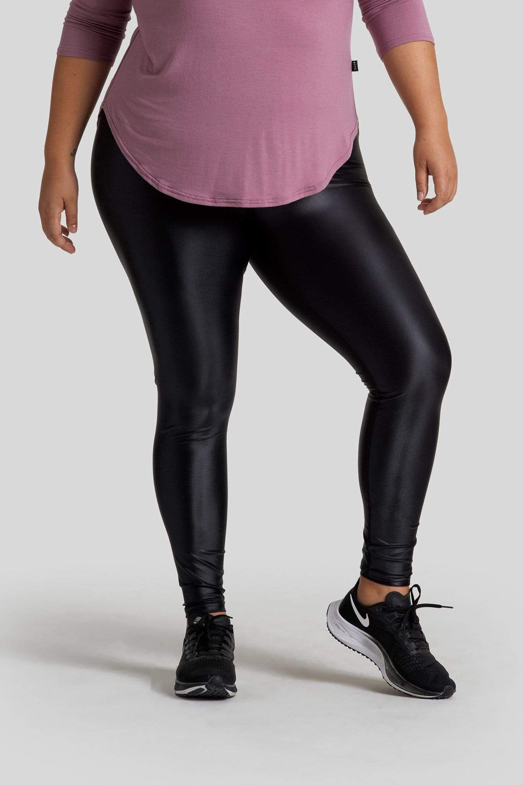 A woman's legs are shown wearing liquid black leggings