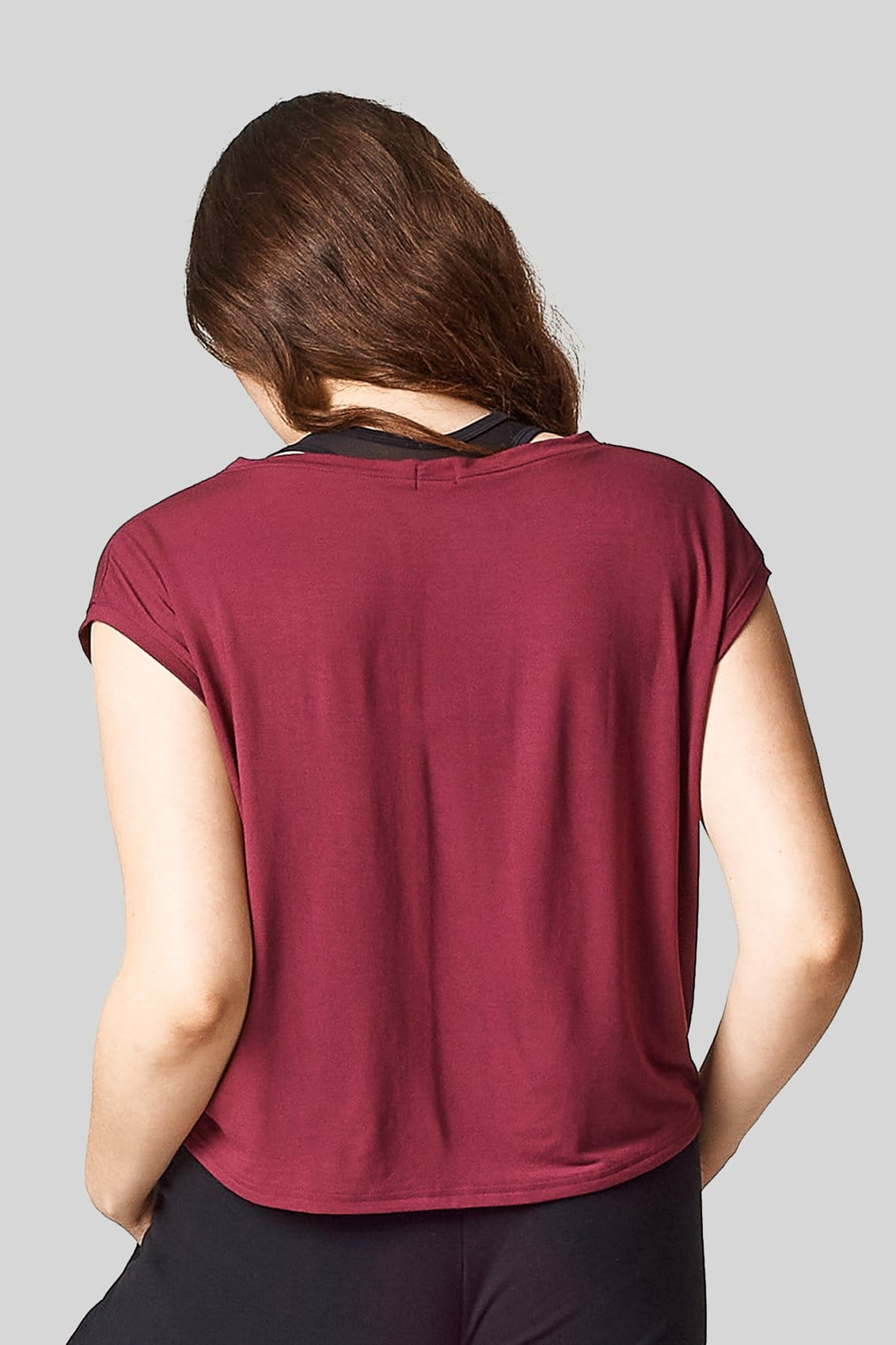A photo shows the back view of red boxy tee shirt.