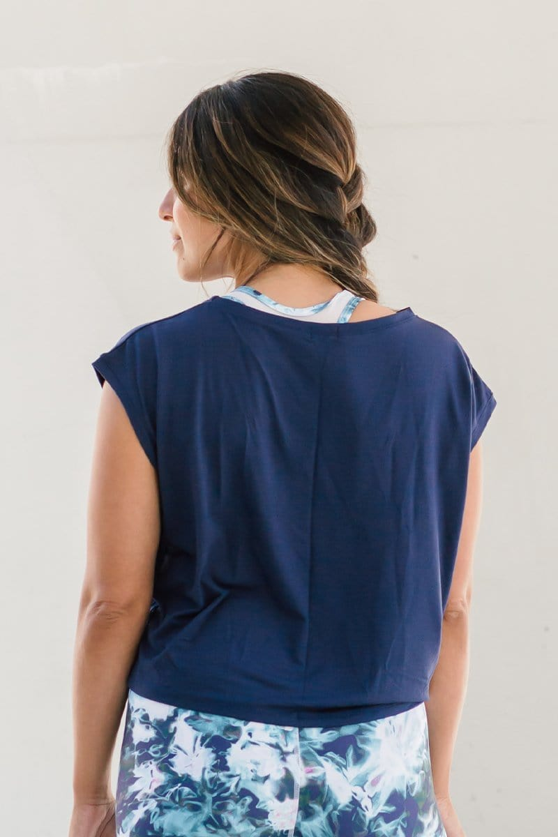 Back view of woman wearing cropped tee in navy blue made ethically in Canada from OEKO-TEX Standard 100 fabric sustainable basics online.