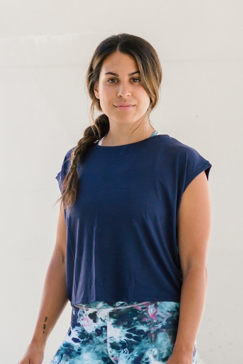 Woman standing wearing cropped tee in navy blue made ethically in Canada from OEKO-TEX Standard 100 fabric sustainable basics online.