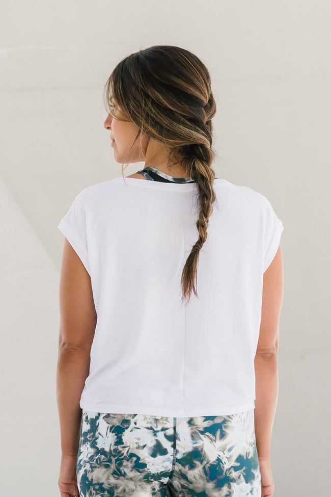 Woman wearing white basic cropped t-shirt made ethically in Canada from OEKO-TEX Standard 100 fabrics.