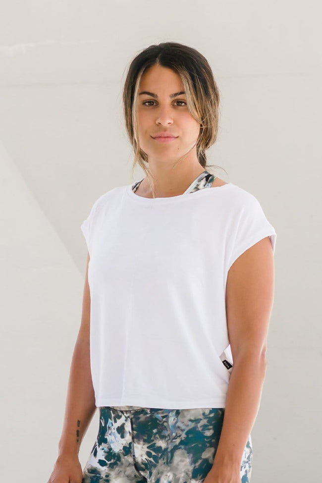 Woman wearing white basic cropped tee made ethically in Canada from OEKO-TEX Standard 100 fabrics.