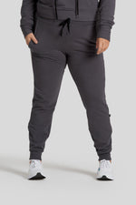 A woman's legs are shown wearing graphite colored joggers