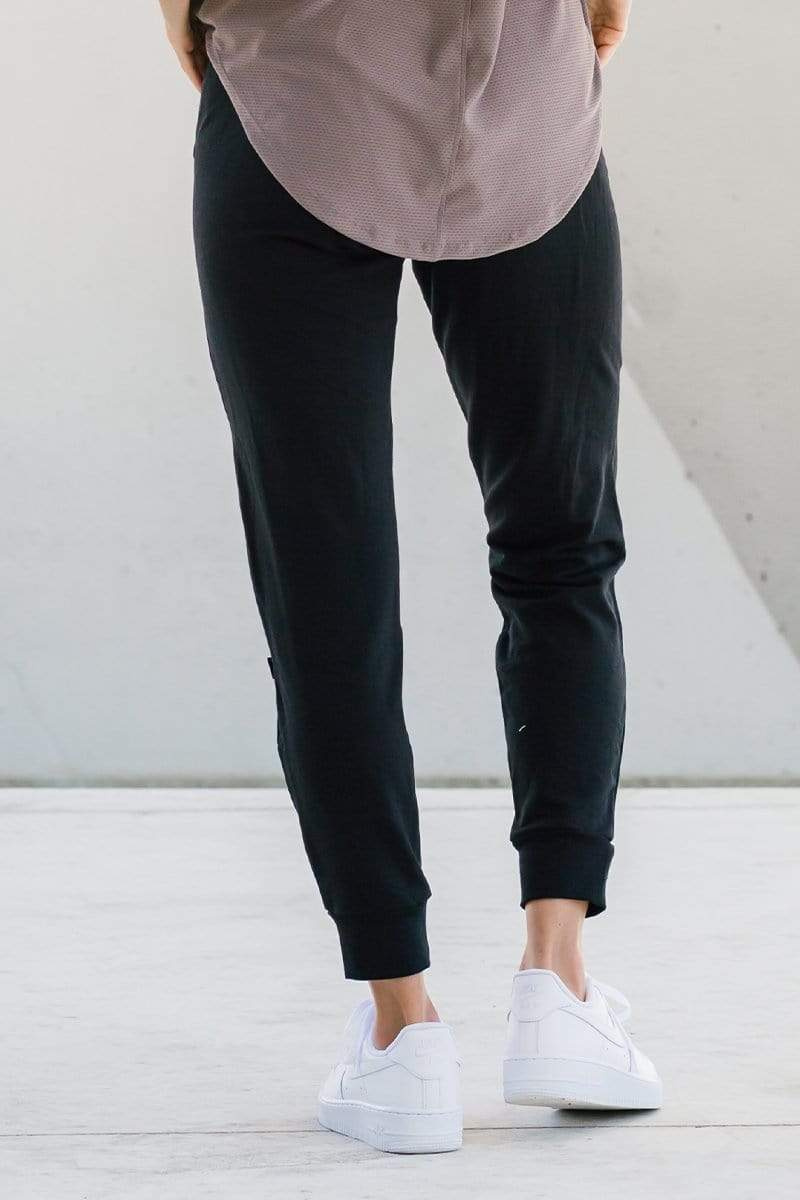 Woman wearing comfortable dressy lounge sweatpants in black made with sustainable fabrics for sustainable made-in-Canada joggers.