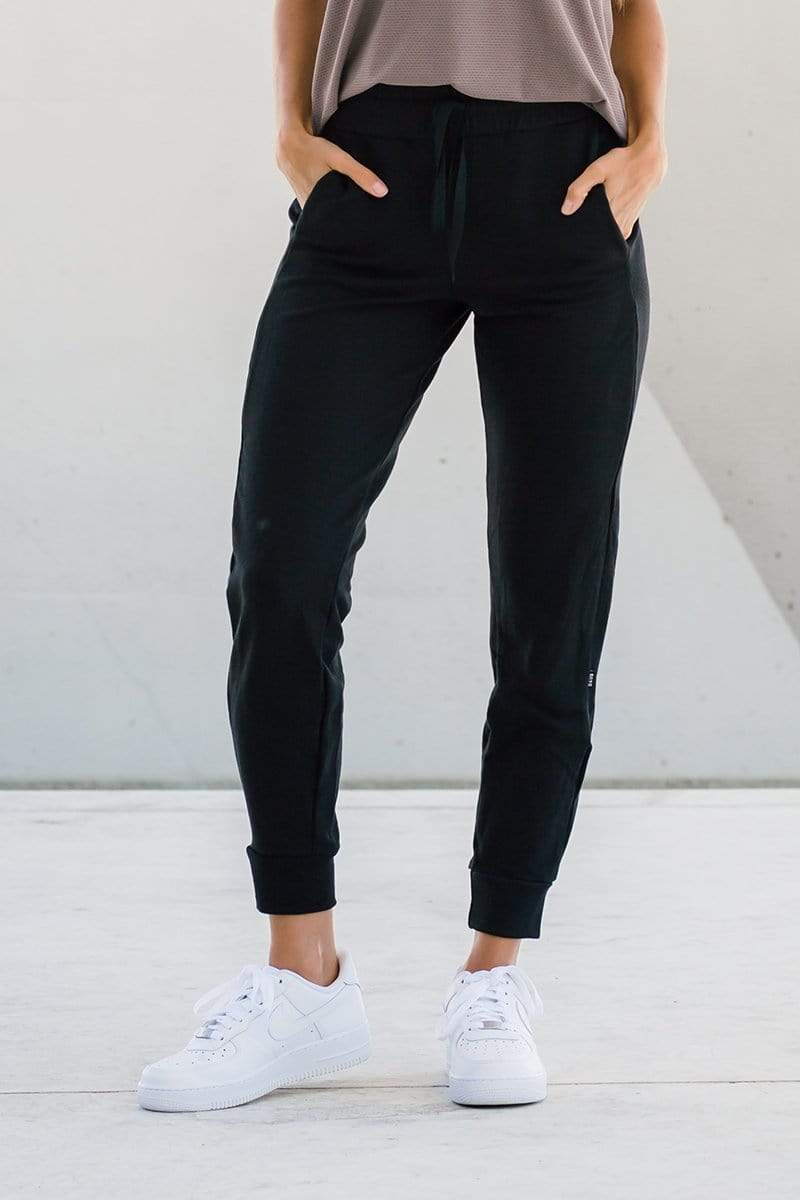 Woman wearing dressy joggers in black made ethically in Canada with sustainable fabrics, sustainable jogger sweatpants available online in Canada.