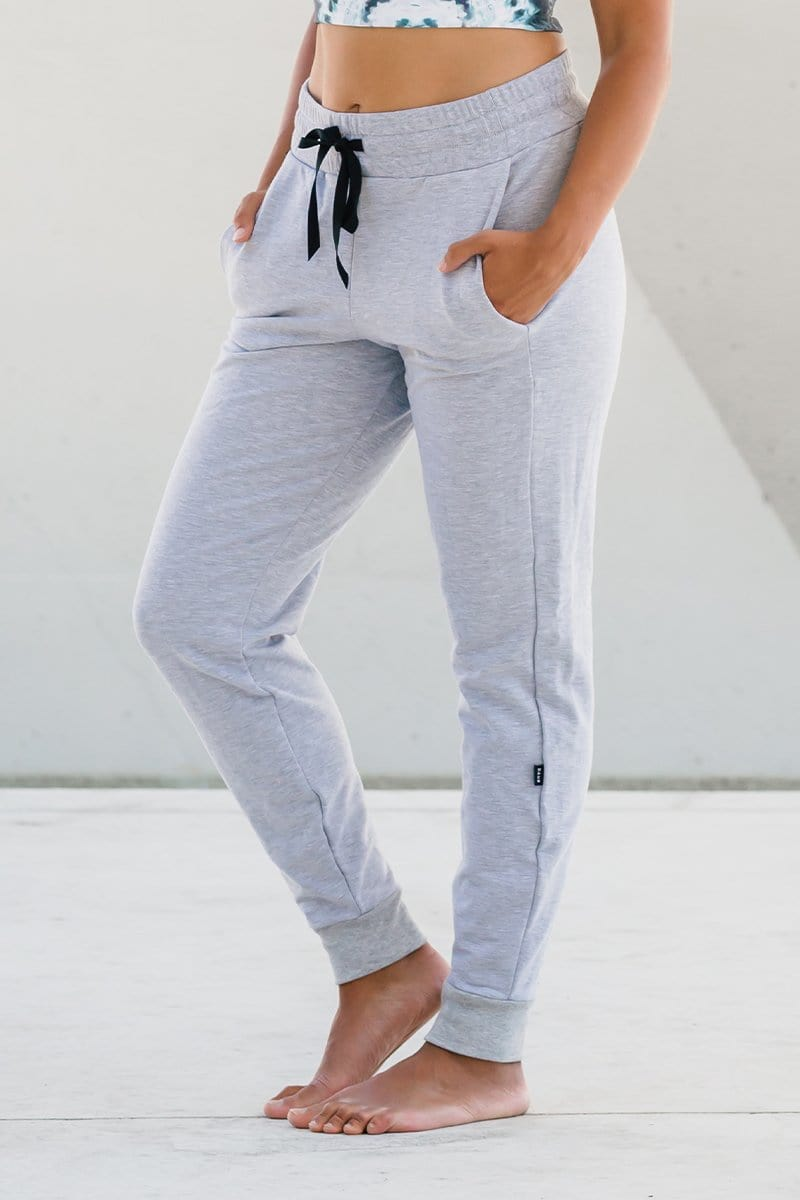 Woman wearing light grey jogger sweatpant made in Canada activewear made from OEKO-TEX sustainable fabrics sustainable jogger lounge pant.