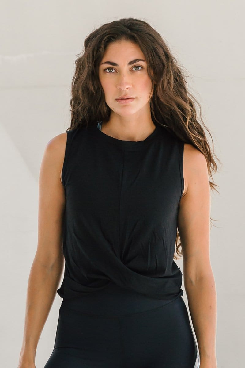 Woman in basic black cropped tank top made of OEKO-TEX fabric ethically-made in Canada.