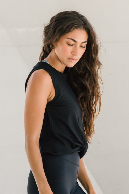 Woman in basic black cropped tank top made of OEKO-TEX fabric ethically-made in Canada basics and black workout sets.