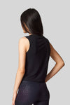 The back view of a sleeveless tank in black worn with black cheetah print leggings.