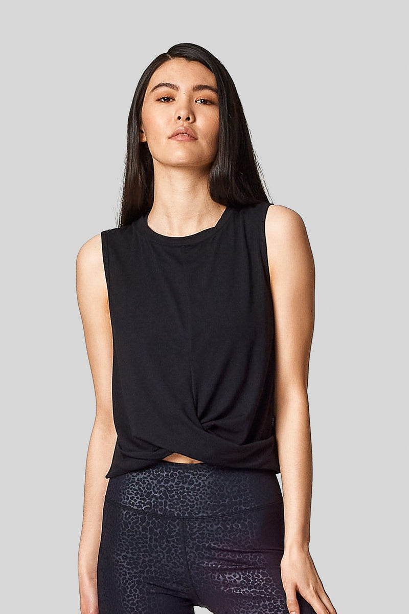 A black sleeveless tank with criss cross twisty front. Slightly cropped.