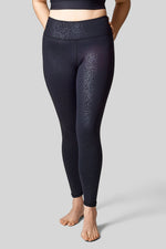 Size 12 model wearing size L in the high waisted leggings in black Cheetah print.