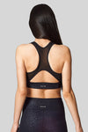 Back view of a racerback sports bra with mesh back.