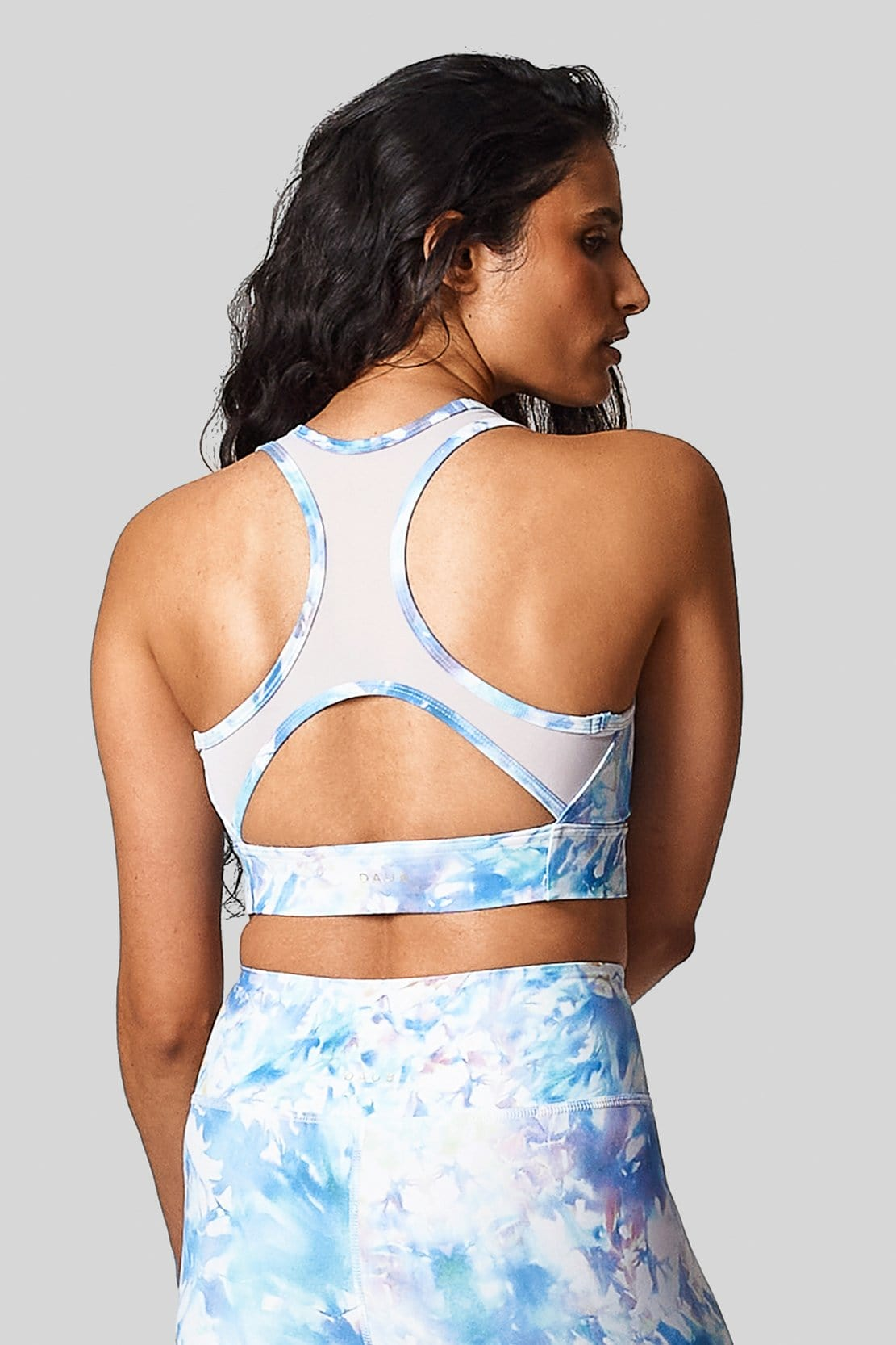 Back view of a long line sports bra with cut out and mesh racerback.