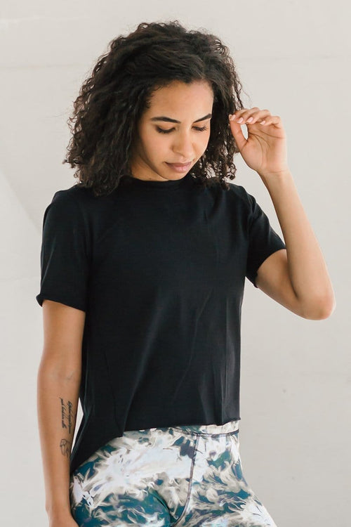 Woman wearing black open-back OEKO-TEX tee made ethically in Canada.
