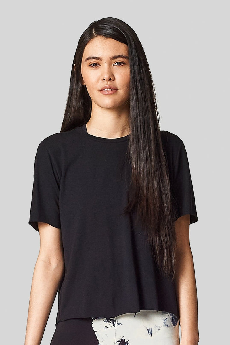 A young asian model wears a black crewneck tee shirt