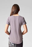 A brunette wears a grey t-shirt with baseball hem & short sleeves in tencel & organic cotton.