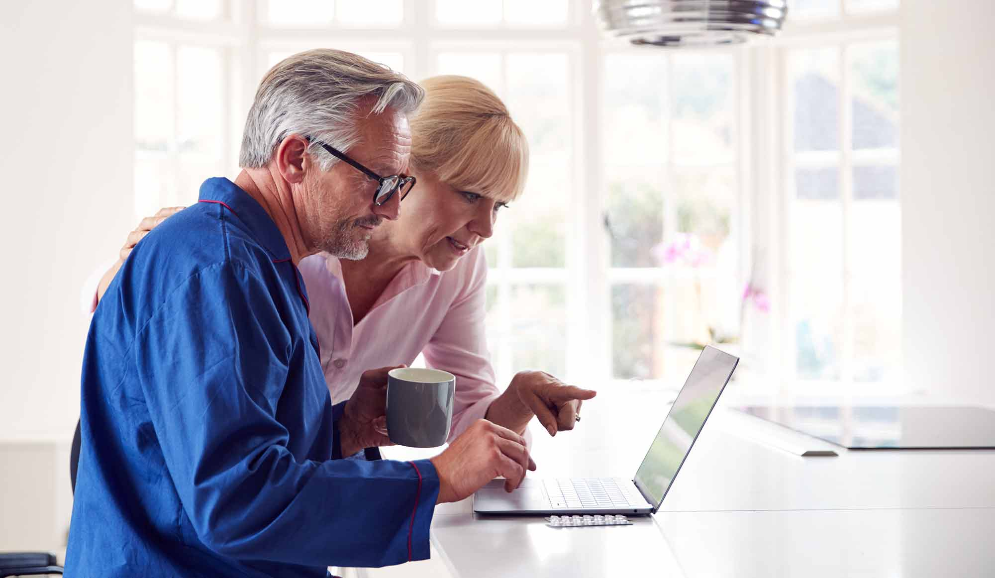 couple researching eye vitamins on computer