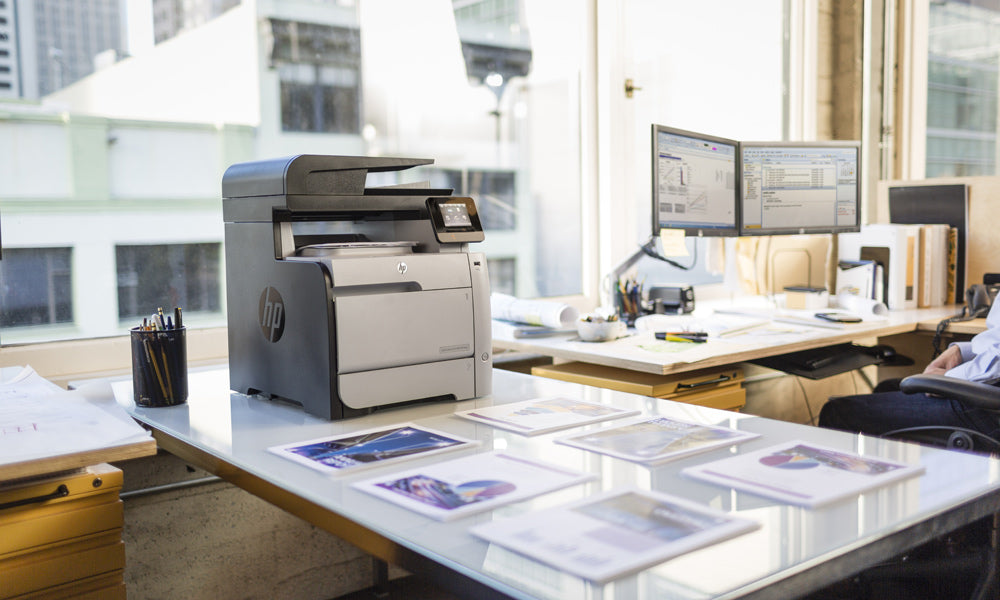 Office with large desk and HP desktop multifunction printer with LCD smart screen