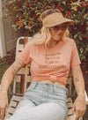 Mother sitting in lawn chair in vintage breastfeeding t shirt
