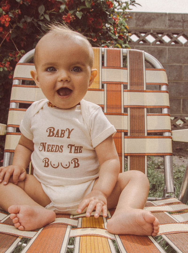 Happy baby waring funny baby onesie