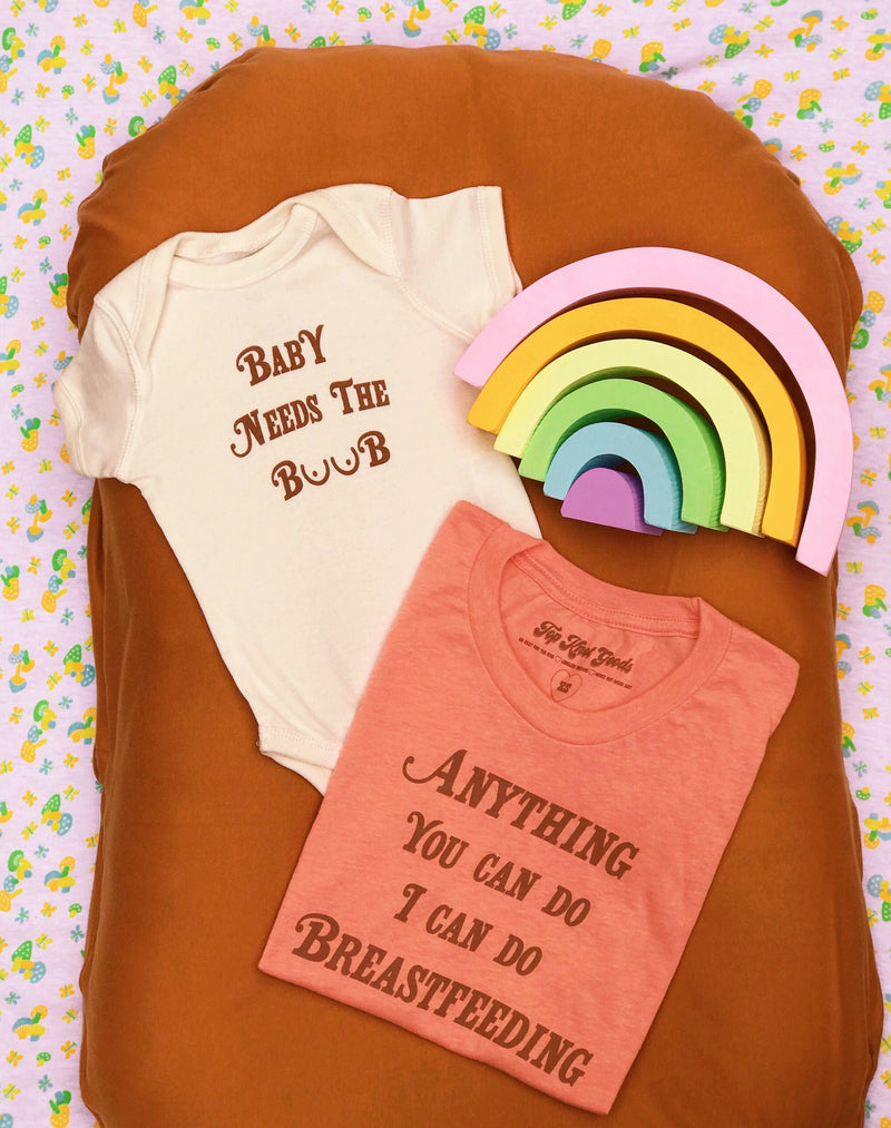 Mother and baby clothign set feauting one baby onesie and one t shirt