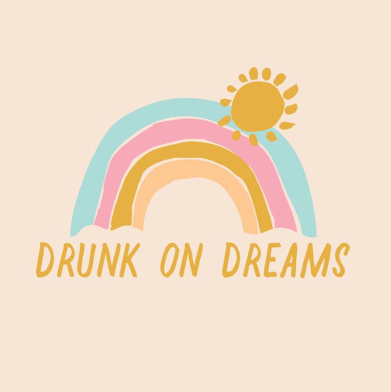 Art work that says Drunk on Dreams with a colorful rainbow and sun