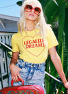 Model wearing sunglasses and yellow vintage Legalize Dreams t shirt