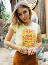 Girl wearing yellow Moon Swoon tee from Top Knot Goods