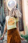 Girl shaking her hair wearing yellow Moon Swoon vintage inspired tee from Top Knot Goods