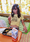 Brunette girl eating a TV dinner while wearing a Same Day Different Shit tee by Top Knot Goods