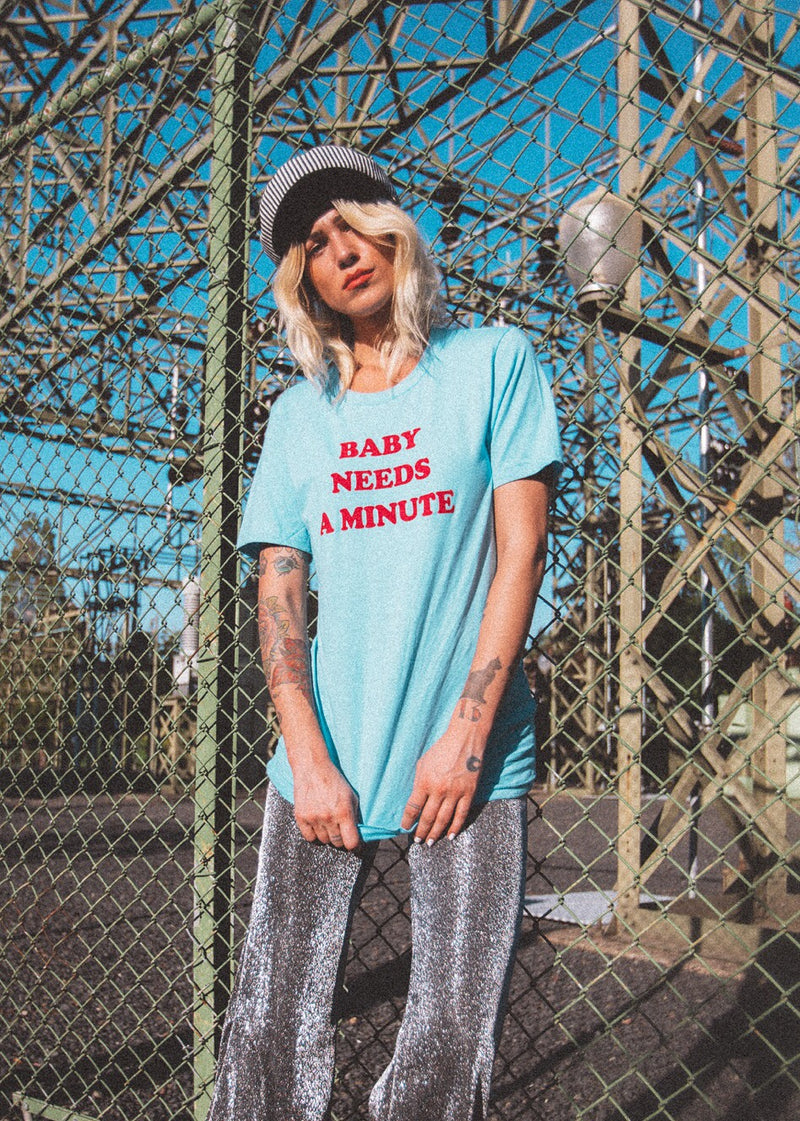Baby Needs a Minute t-shirt by Top Knot Goods