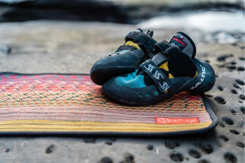 Pair of climbing shoes on a mat