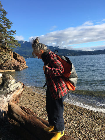 Sue putting on her Turtleback outdoor swimming bag beside a lake