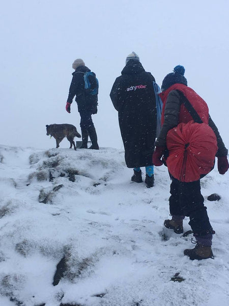 Jamima and swim friends walking up a hill in the snow with an early version of the Turtleback bag