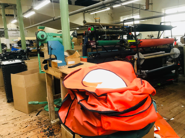 A pile of Turtleback bags in the factory ready to be finished