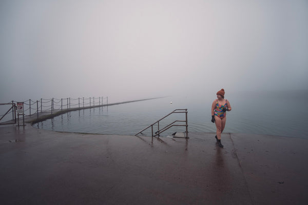 Lauren on a lido with misty water behind her