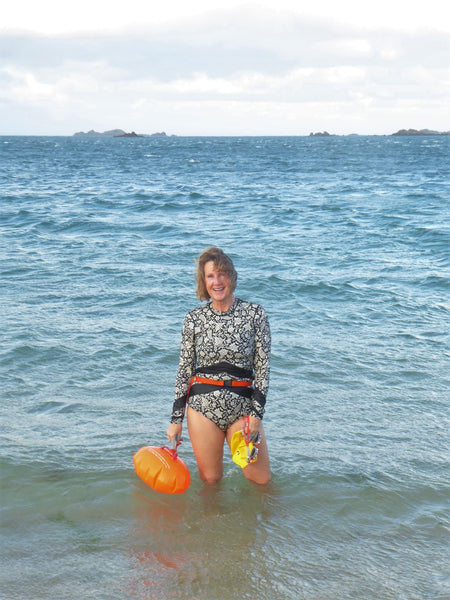 Anna standing out in the sea at knee height