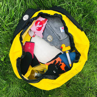 Yellow Turtleback outdoor swim bag from above with swim kit inside