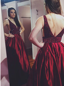 A Line V Neck Red Satin Open Back Prom Dress with Beadings and Pockets