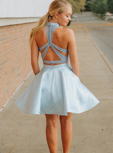 Blue Two Piece Halter Criss Cross Satin Homecoming Dress with Beading and Pockets