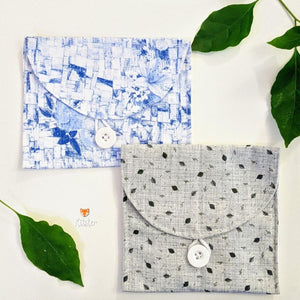 2 beautiful cloth pouched with a flap and button closure - printed blue and grey designs that are delicate and pretty.