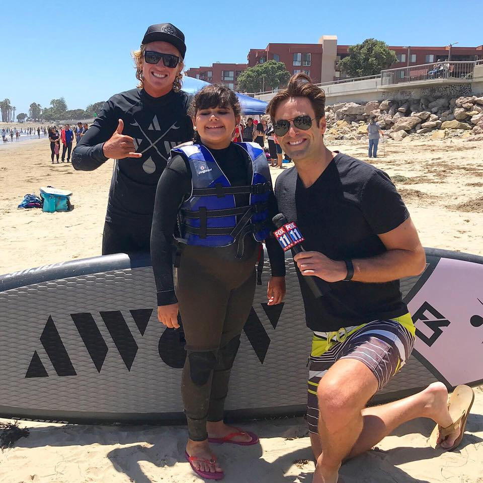 Surf Therapy: Blind 12-year-old learns to surf with help from unique friends