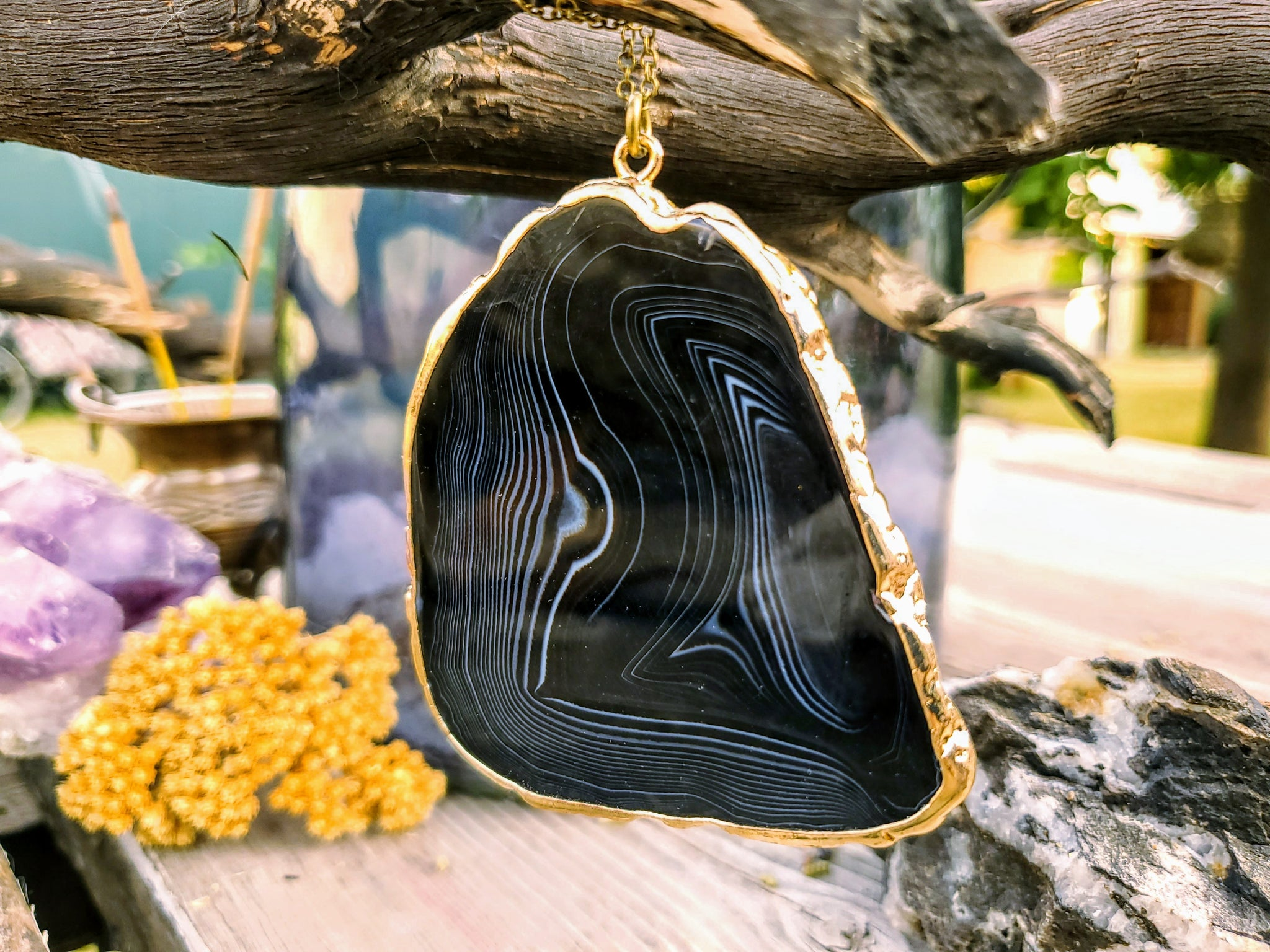 a black and white quartz pendant gemstone necklace rimmed in gold