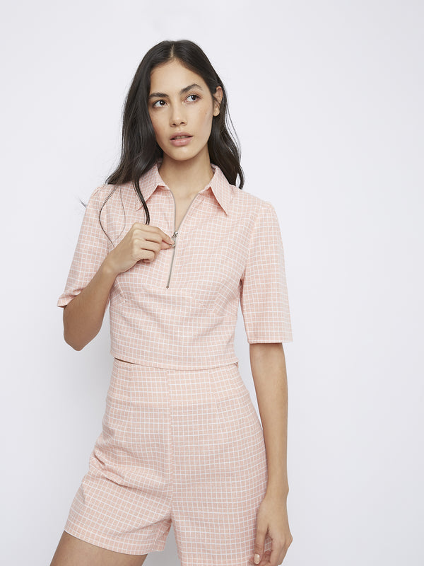 Peach grid pattern zip top